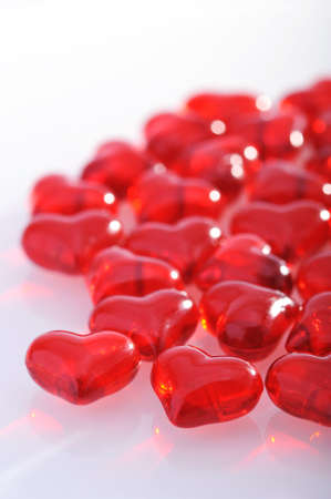cordiality: Red glass-hearts on white background Stock Photo