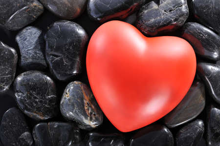 cordiality: Red heart on black stones
