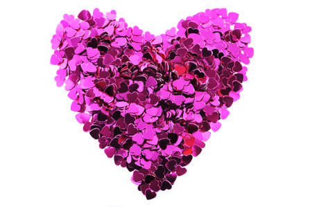 cordiality: close-up view of many small pink glitter hearts in form of a heart