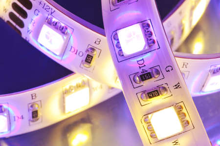 leds: macro detail of a RGB-LED-stripe combined with warmwhite LEDs in colored spotlight Stock Photo