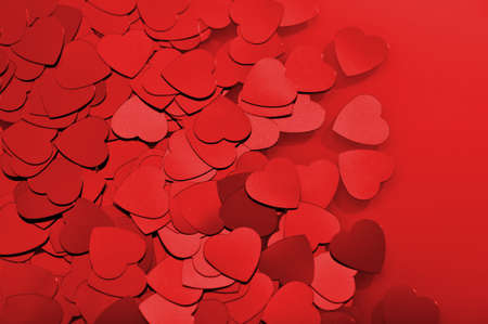cordiality: close-up view of many small red glitter hearts