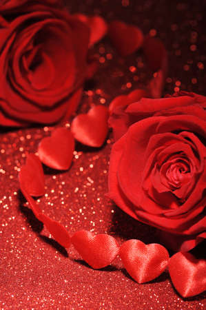 mother'sday: chain of textilehearts with red roses on red sparkle background Stock Photo