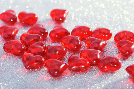 cordiality: Red glass-hearts on silver sparkle background
