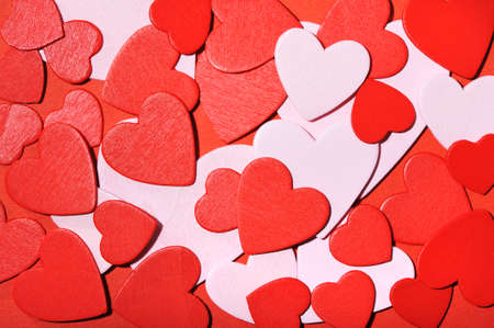 mother'sday: many small red and white wood hearts on red background