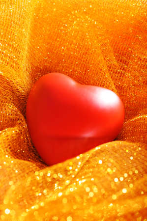 Red heart on golden sparkle background
