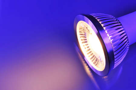 light color: macro detail of a warmwhite COB-LED in blue-violet spotlight Stock Photo