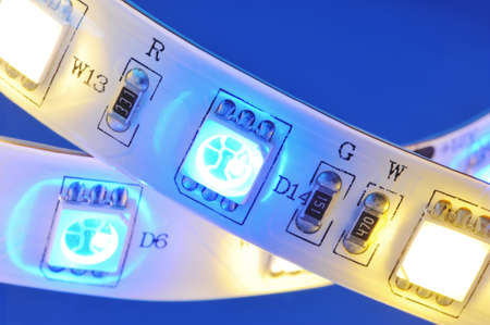 macro detail of a RGB-LED-stripe combined with warmwhite LEDs in colored spotlight Фото со стока