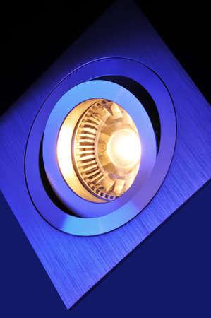 led lighting: macro detail of a warmwhite COB-LED in blue spotlight