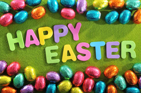 many colored: Many colored chocolate easter eggs with Happy Easter lettering Stock Photo