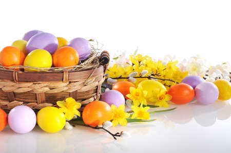 hen's: original easter eggs in yellow, violet and orange with flowers and easter nest on white background