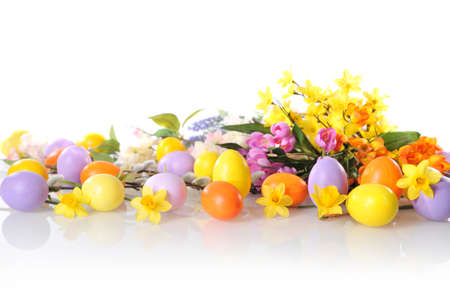 hen's: original easter eggs in yellow, violet and orange with flowers and catkin on white background