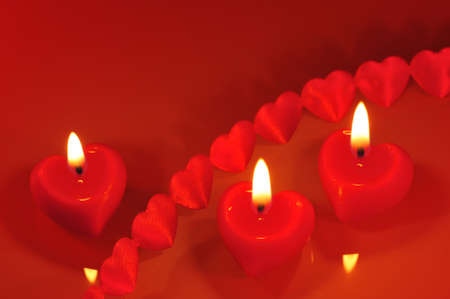 three luminous red candle hearts with textile arts before photo