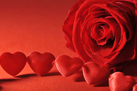 chain of textile arts before with red rose on red background Stock Photo