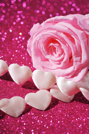 mothersday: chain of white textile arts before with pink rose on pink sparkle background Stock Photo