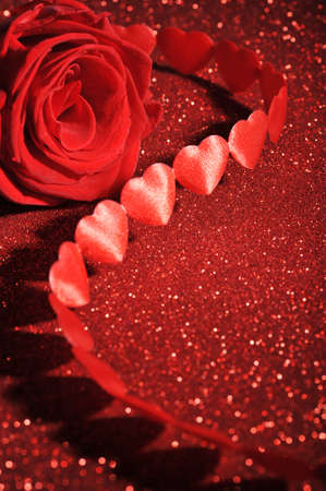 cordiality: chain of textile arts marriage with red rose on red sparkle background