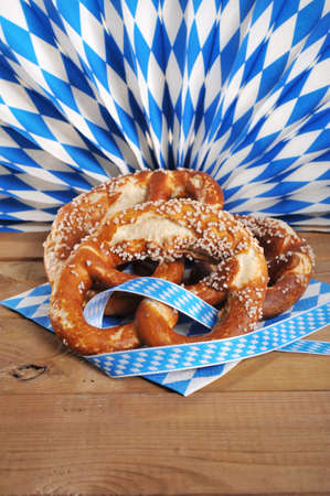 Three original Bavarian salted pretzels soft in front of bavarian diamond fan
