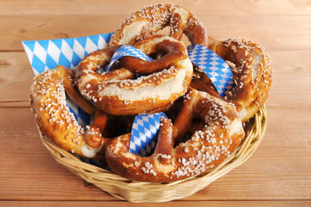 oktoberfest: Original Bavarian Oktoberfest pretzels salted soft in a basket on wooden board Stock Photo