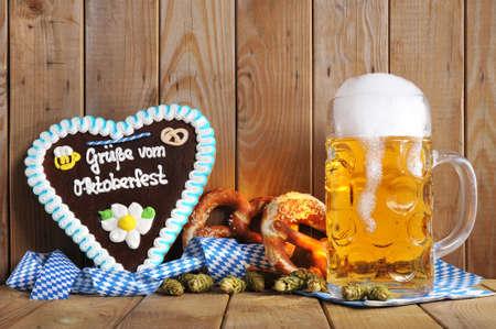 oktoberfest: original bavarian gingerbread heart with Oktoberfest beer mug and soft pretzels Stock Photo