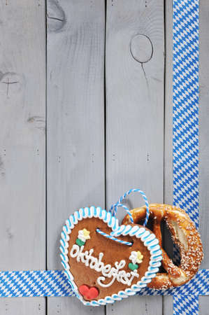 Original Bavarian salted pretzels soft Oktoberfest gingerbread heart in front of wooden board