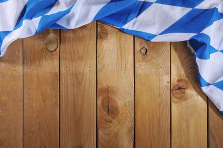 Oktoberfest in Germany Original Bavarian flag on old weathered wooden board. Background with copyspace. Banco de Imagens