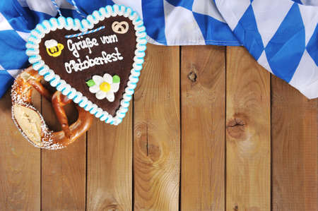 regards: Regards from the original Oktoberfest bavarian gingerbread heart with Bavarian flag and soft pretzel from Germany
