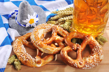 Oktoberfest bavarian original soft pretzels with Oktoberfest beer mug on Bavarian flag from Germany