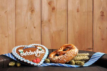 gingerbread heart: Bavarian Oktoberfest pretzel soft with gingerbread heart hops, and wheat from Germany on old beer barrel