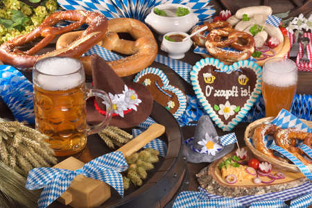 beerglass: All typical German Bavarian symbols in one picture. Gingerbread heart, soft pretzels, Bavarian veal sausage and beer.