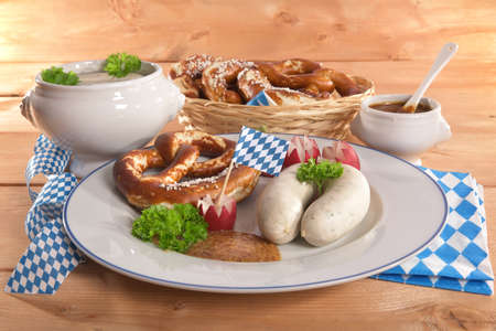 veal sausage: Bavarian veal sausage breakfast with sausages soft, pretzel and mild mustard on dark weathered wooden board