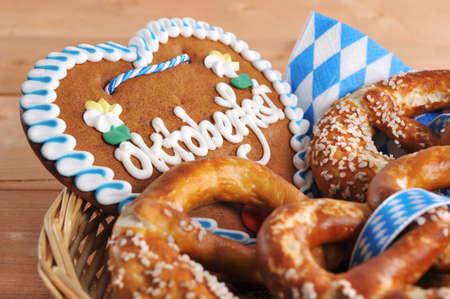 gingerbread heart: Original Bavarian Oktoberfest pretzels salted soft with gingerbread heart in a basket from Germany on wooden board