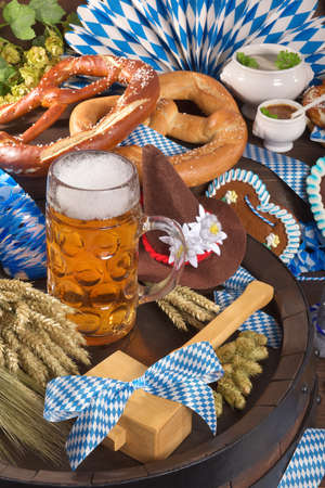 veal sausage: All typical German Bavarian symbols in one picture. Gingerbread heart, soft pretzels, Bavarian veal sausage and beer.