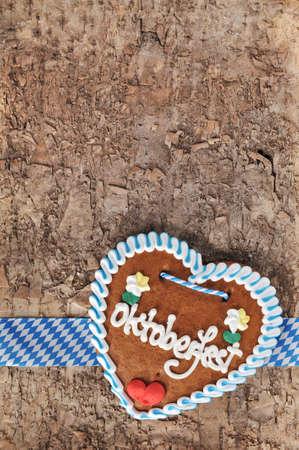 gingerbread heart: Original Bavarian Oktoberfest gingerbread heart from Germany on real brown tree bark Stock Photo