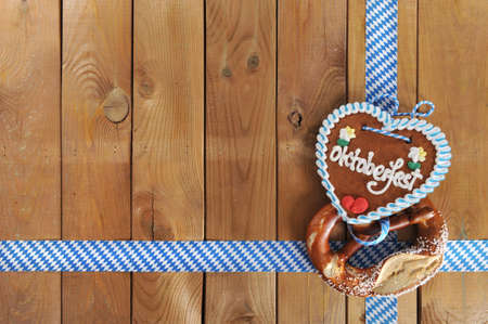 gingerbread heart: Original Bavarian salted pretzel soft and Oktoberfest gingerbread heart from Germany in front of wooden board Stock Photo