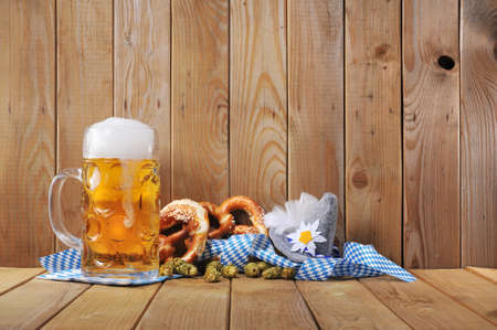 beerglass: original bavarian pretzels soft with Oktoberfest beer mug and costume has from Germany
