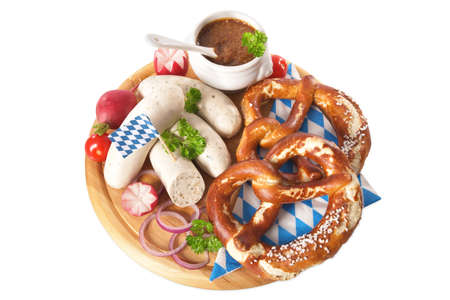 veal sausage: Bavarian veal sausage breakfast with sausages soft, pretzel and mild mustard on wooden board from Germany Stock Photo