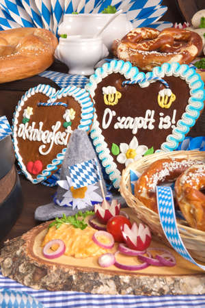 veal sausage: All typical German Bavarian symbols in one picture. Gingerbread heart with The beer is tapped text, soft pretzels and Bavarian veal sausage