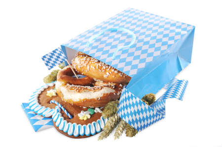 carryall: Bavarian Oktoberfest paper shopping bag with gingerbread heart soft, pretzel, hops and wheat from Germany