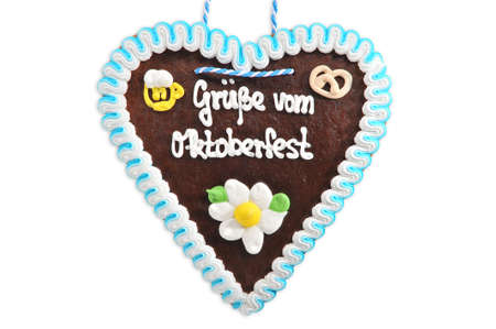 regards: Regards from the Oktoberfest - original Bavarian Oktoberfest gingerbread heart from Germany on white background