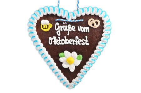 oktoberfest: Regards from the Oktoberfest - original Bavarian Oktoberfest gingerbread heart from Germany on white background