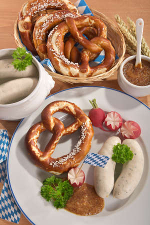 veal sausage: Bavarian veal sausage breakfast with sausages soft, pretzel and mild mustard on weathered wooden board from Germany