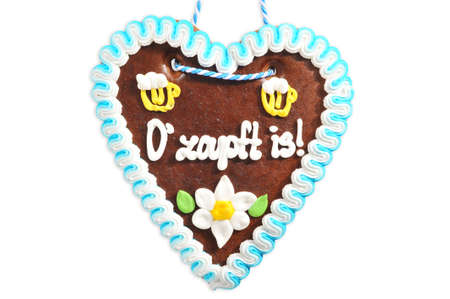 The beer is tapped - original Bavarian Oktoberfest gingerbread heart from Germany on white background Standard-Bild