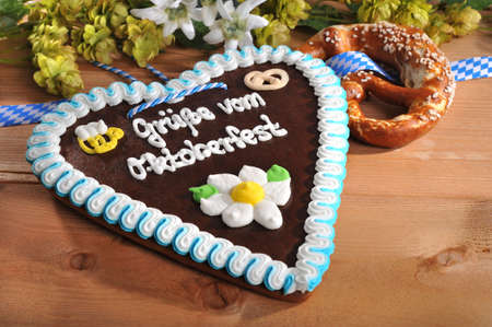 gingerbread heart: Regards from the Oktoberfest - original bavarian gingerbread heart with soft pretzel and hops from Germany Stock Photo