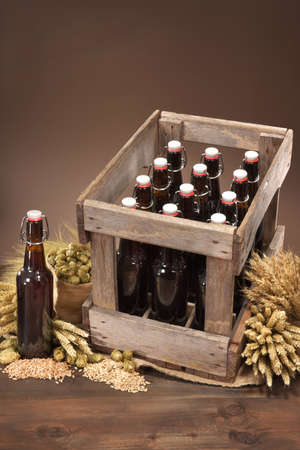 beer crate and beer bottle with hops, wheat, grain, barley and malt