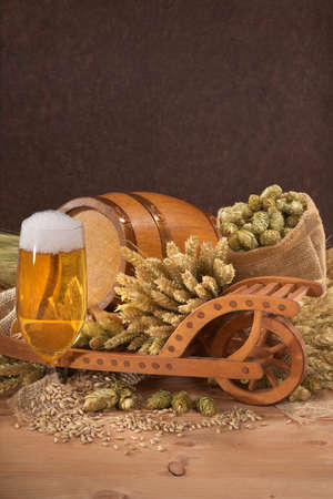 beerglass: beer glass with wood barrel with wheelbarrow, hops, wheat, grain, barley and malt