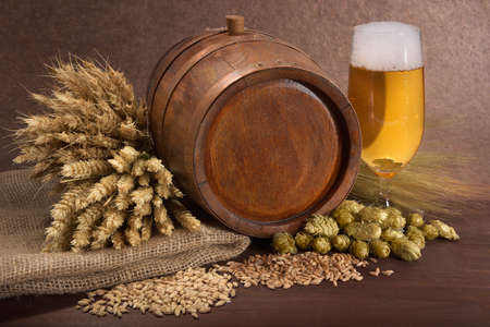 beerglass: old wood barrel with beer glass, hops, wheat, grain, barley and malt