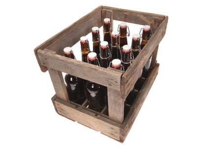 old beer crate with beer bottles isolated on white