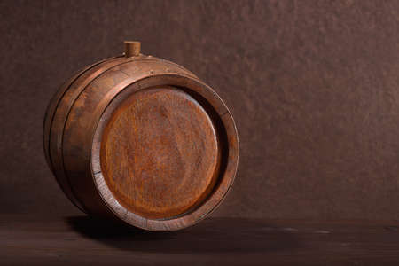 old wood barrel with copper rings and plug