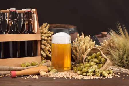 beer crate, beer barrel and beer glass with hops, wheat, grain, barley and malt Stock fotó