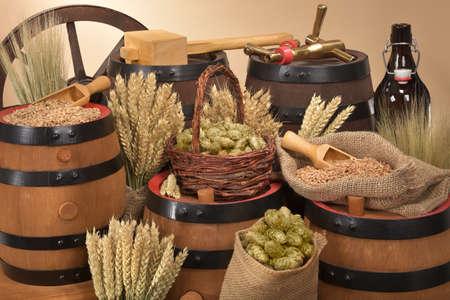 beer barrel, beer bottle, hammer and spigot with hops, wheat, grain, barley and malt Stok Fotoğraf