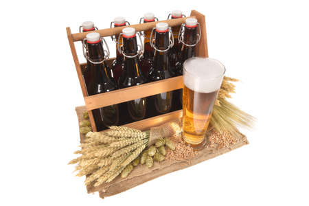 beerglass: beer crate and beer glass with hops, wheat, grain, barley and malt isolated on white